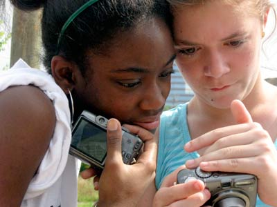 Teen photographer Alex Nelson captured Praycious Wilson-Gay and Rosalia Preiss editing their photographs.