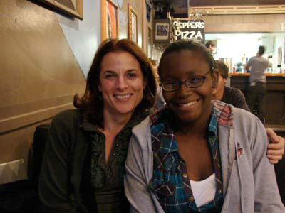 Photo Caption – Barbara Haight and Sharika Strickland enjoy pizza together and hear about teen involvement with the Durham VOICE as part as one of their weekly Tuesday outings. Photo by Claire Atwell