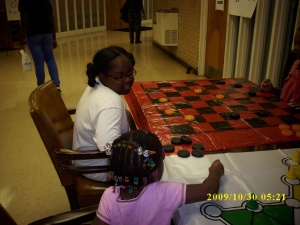 Lauren Jones 9, and Katelyn McNeil,3, playing Checkers during the Hallelujah Carnival at St. Joseph's A.M.E. Church