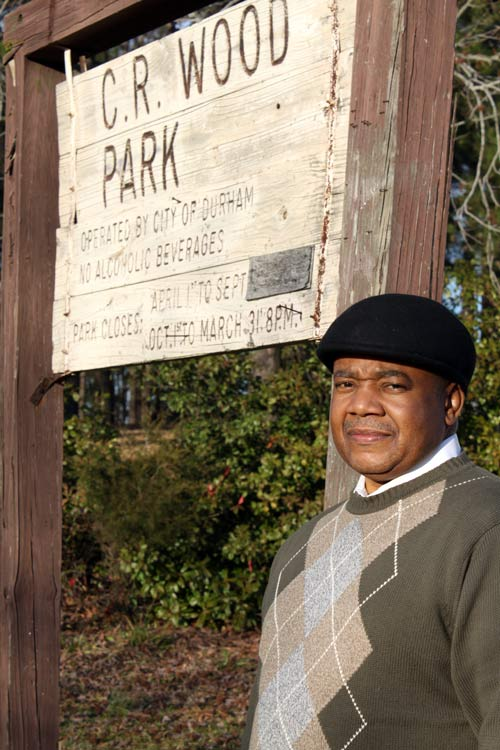 The Rev. Sylvester Williams, a community leader concerned with the East End Connector Project, stands at the entrance to Durham's E.C. Woods Park which will lose a small amount of land to the project.