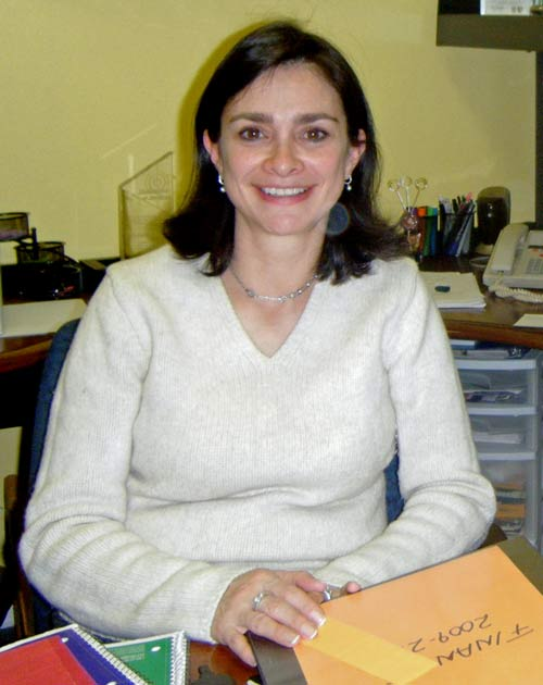 """El Centro Hispano's executive director, Pilar-Rocha Goldberg, sits at her desk planning """"Unidos por Haiti,"""" a fundraising event that the Hispanic community has put together to help victims of the Haiti earthquake. (Staff photo by Katy Millberg)"""