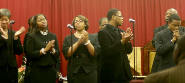 Latia White Boney, Stacy Evans and the members of the praise and worship team start service with an uplifting song. Photo by Corliss Pauling.
