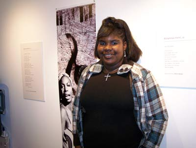 Teen artist Desiree Sanders with her artwork.