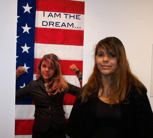 "Teen artist Olivia Nelson poses beside her art work at the exhibit, ""I Am the Dream."""