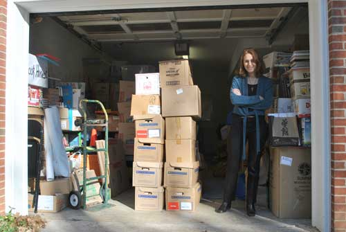 Ginger Young stands in her garage in Chapel Hill, which serves as Book Harvest's warehouse. She collected 16,928 books during a drive on Martin Luther King, Jr. Day. Young hopes to establish a permanent office using the proceeds from the show. (Staff photo by Brian Fanney)