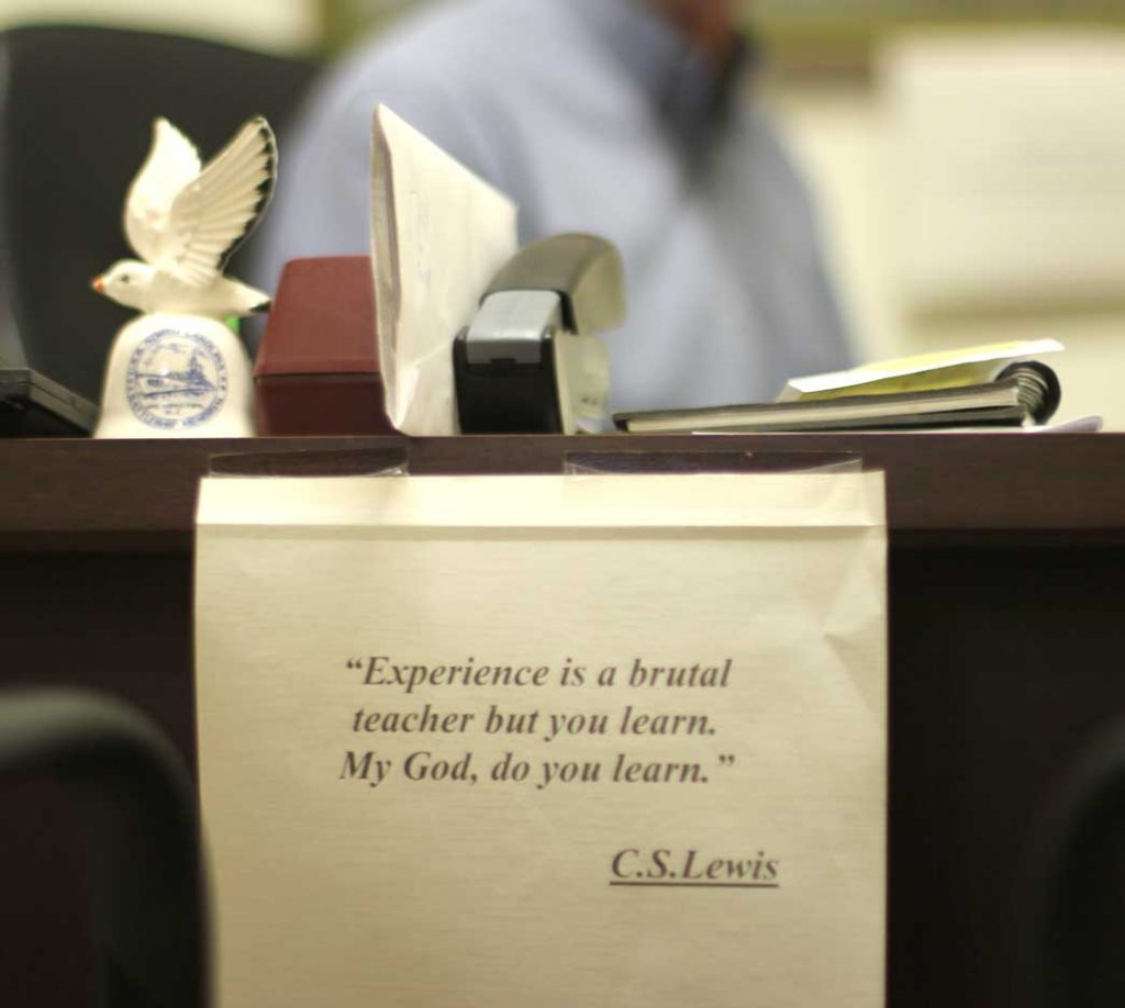 A C.S. Lewis quote hangs on Herman's desk. He first heard the quote on an episode of Criminal Minds, and it stuck with him ever since. (Staff photo by Caitlin Owens)