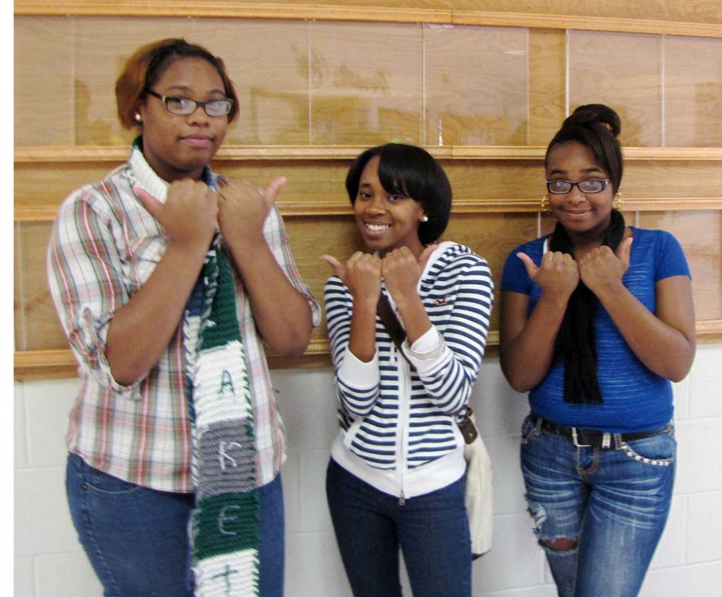 No, that is not a gang sign that (From left to right) Hillside New Tech students Cornelia Powell, Chantelle Love and Jazmyn George are holding up. It is the Bull City symbol. (Staff photo by Mahdiyah Al-askari)