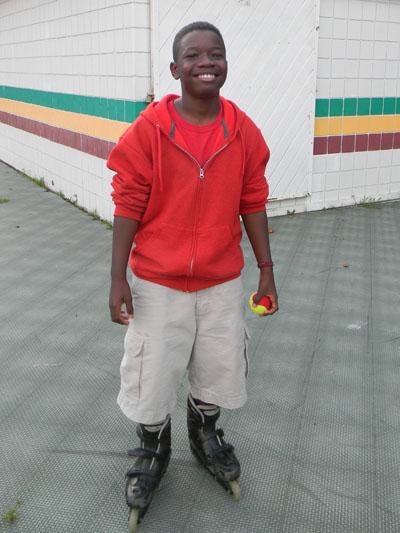 DaShon Johnson, 8, takes a quick break from skating.