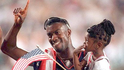 Allen Johnson holds up his daughter, Tristine, after winning the gold medal in the 110-meter hurdles in the 1996 Olympics in Atlanta. (Contributed by Tristine Johnson)