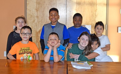 The students in the SEEDS afterschool program are gathered around Katie Williams, the afterschool assistant, (front row, left to right) Alessandro, Oscar Morroy, Katie Williams and Heidi Lopez; (back row, left to right) Marializ Licona-Martinez, Nyles Perry and Adrian Platt (Staff photo by Rashaan Ayesh)